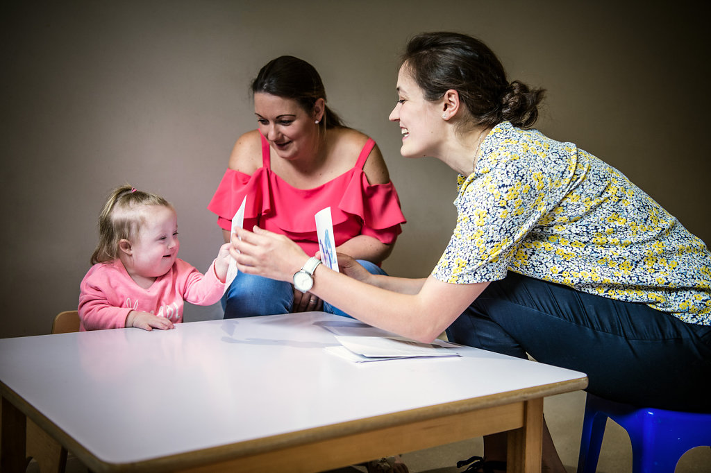 Lily, her mum Nicola, and therapist Katie, for PSDS, a charity that supports families who have children with Down syndrome
