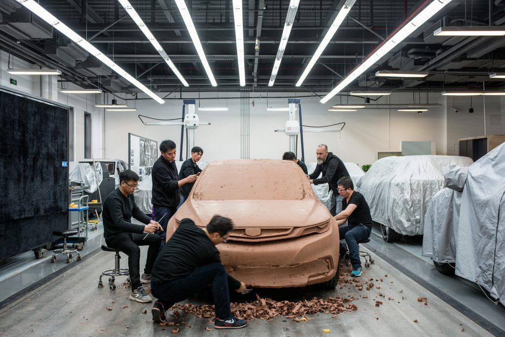Geely technicians and artists working on a clay model, Shanghai for a one off magazine for Geely