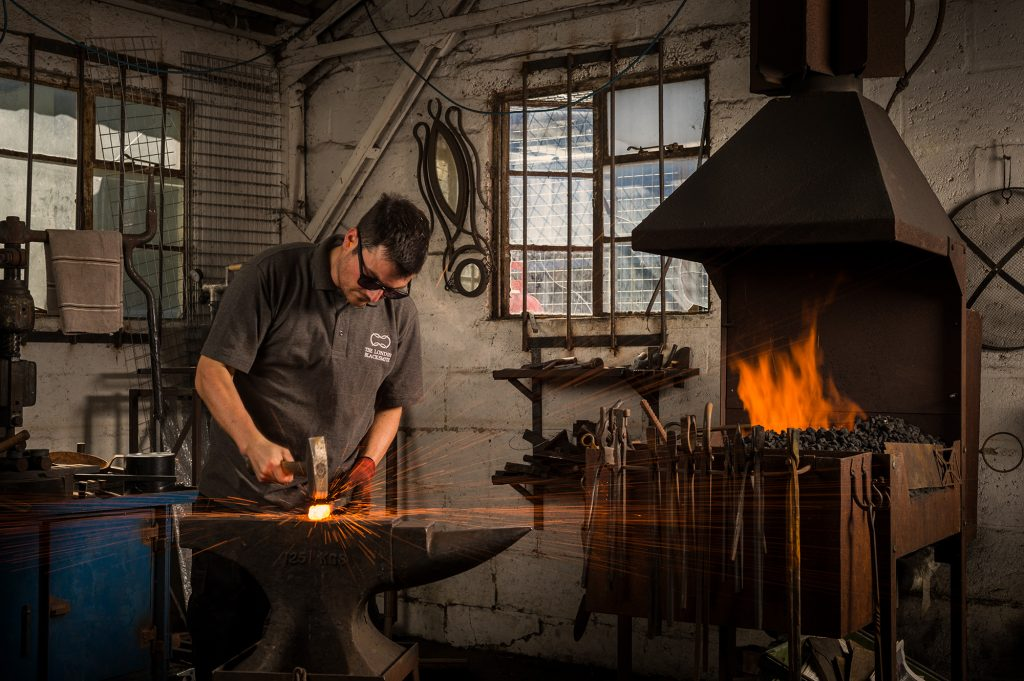 Blacksmith Will Barker in his forge for Lexus.