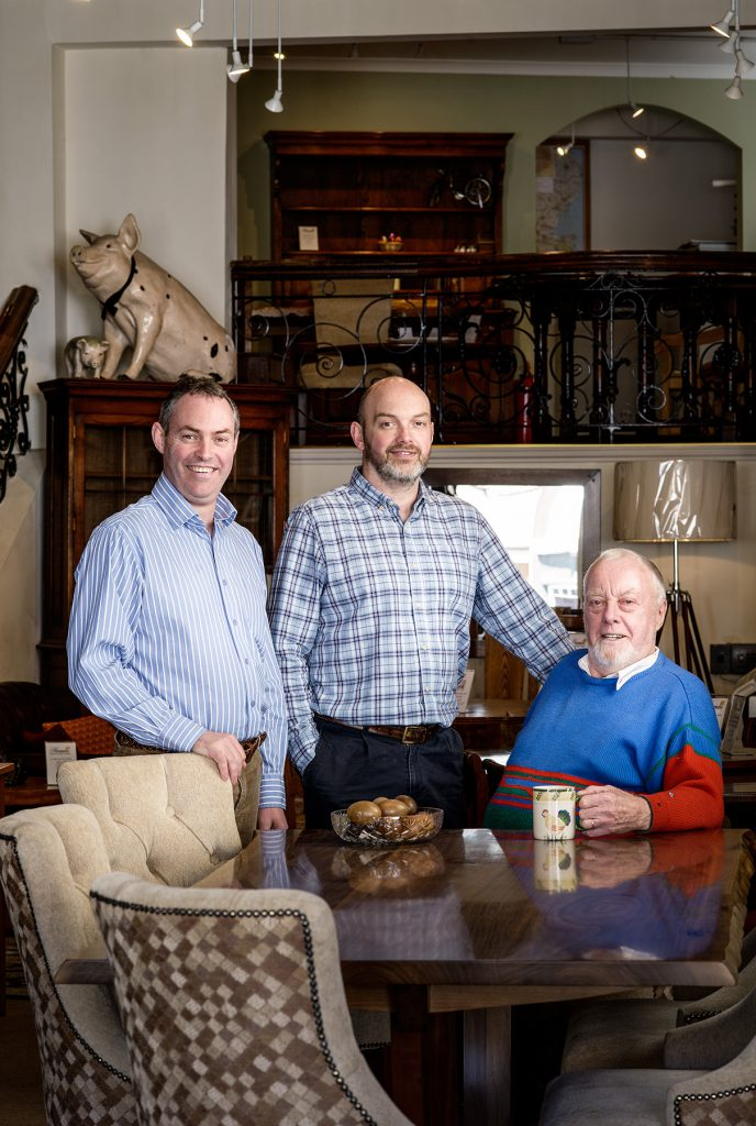 Paul, Nicholas and reginald Harman photographed in their  shop in West Street
