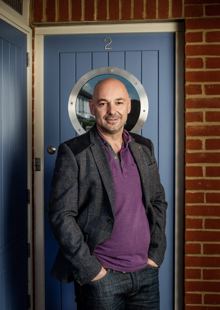 Mel Mehmet photographed outside his home