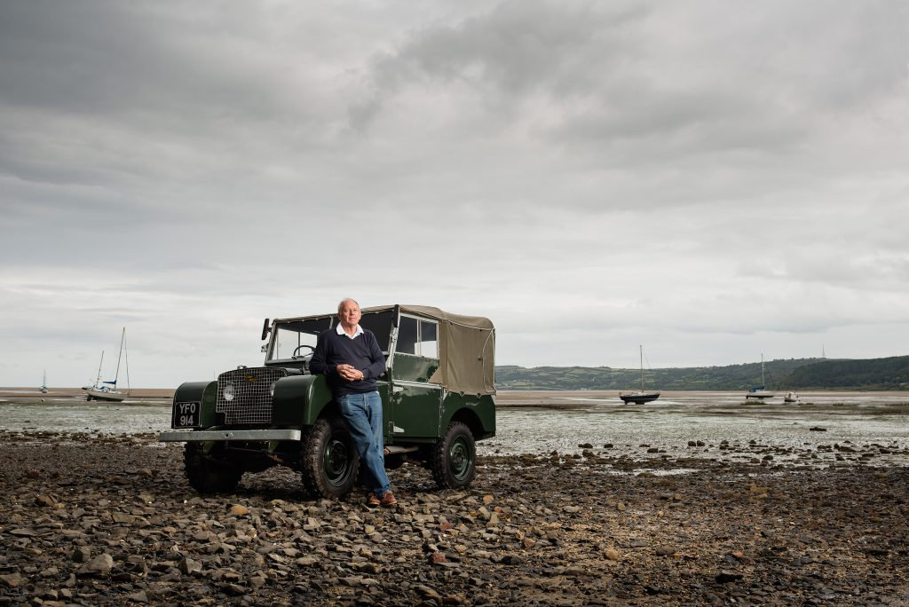 Roger Crathorne and a Land Rover Series 1, Red Wharf Bay, Anglesey for 'Line in the sand' for JLR