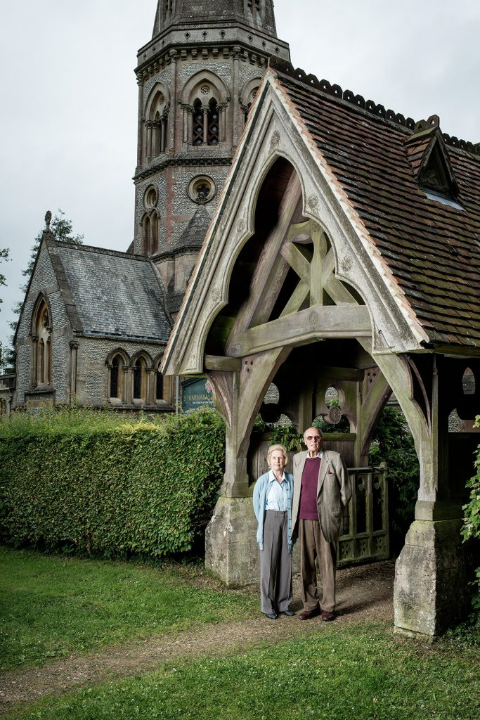 Lady and Sir Hugh Cubitt photographed outside St Barnabus Church, Ranmore
