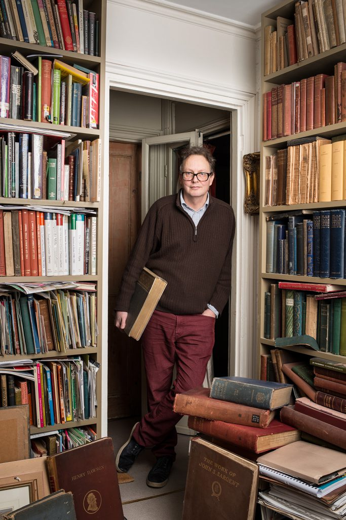 Tim Hill photographed in his home