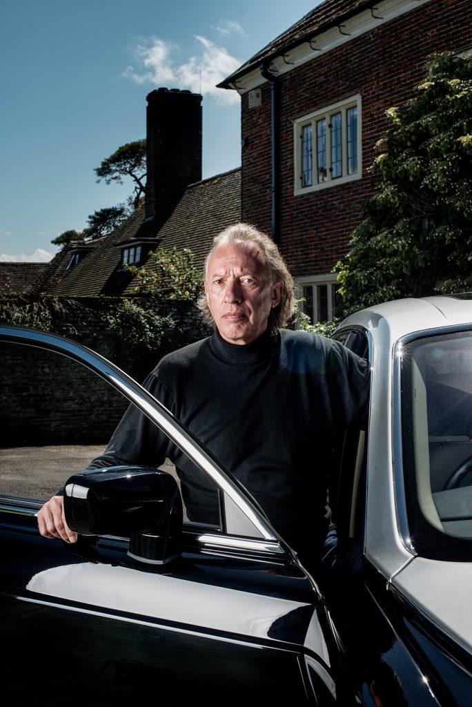 Tony Robinson photographed outside his home